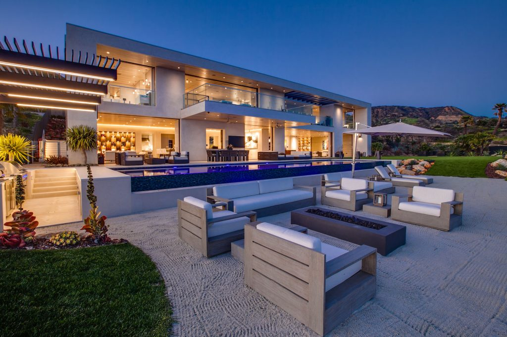 Outdoor pool area with seating and fire pit.
