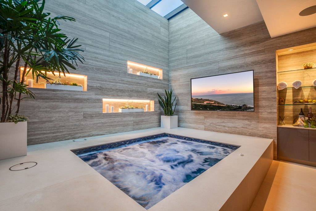 A large jacuzzi with a flatscreen TV.