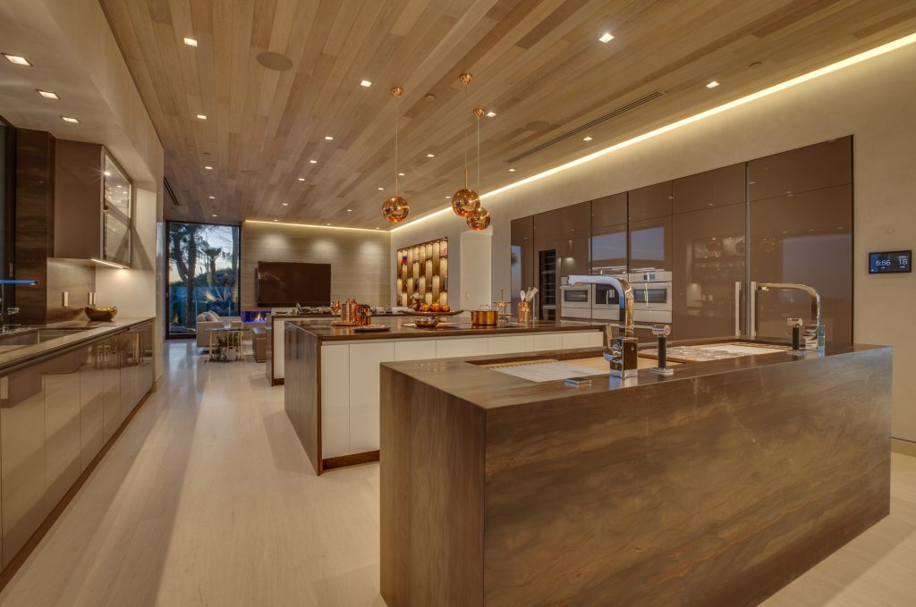 A large contemporary kitchen with sleek fixtures.