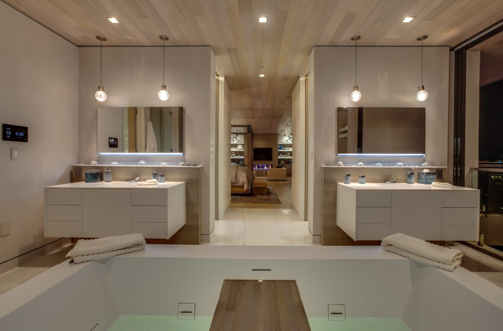 Master bathroom with two vanities and a large tub.