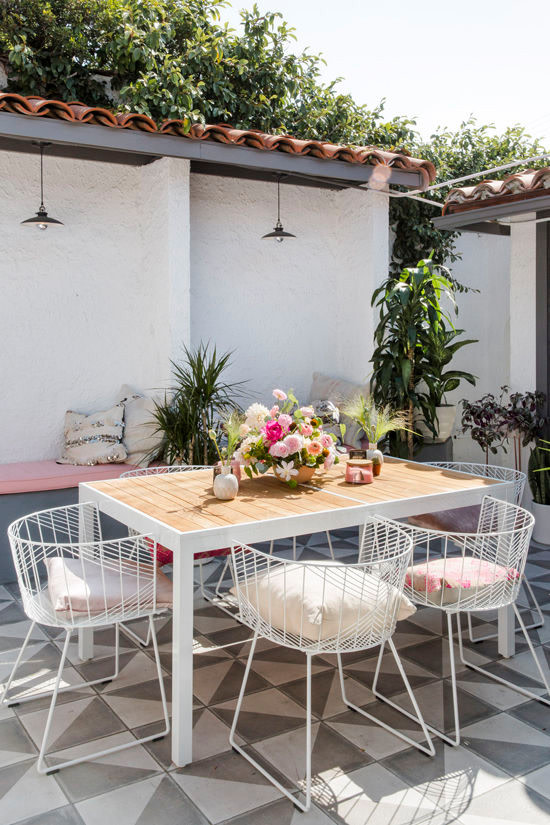 Outdoor dining area with table seating for six.