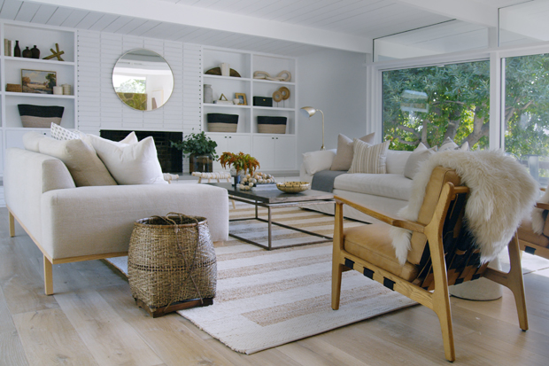A modern bohemian living room with beautiful built in shelves.