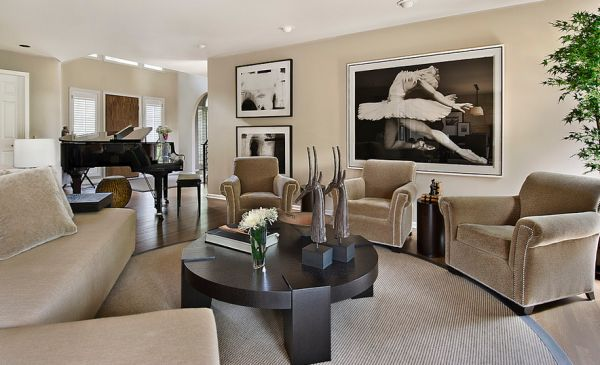 A living room with black and white photography on the wall.