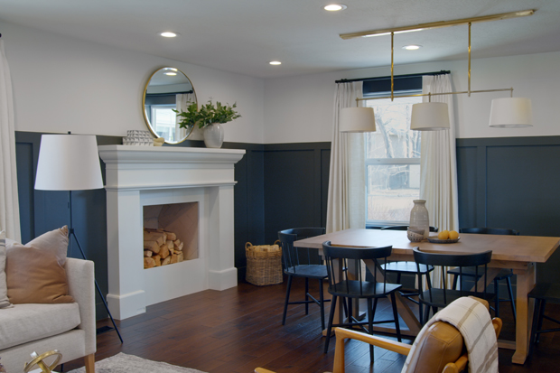 View of a dining area with the fireplace as a focal point.