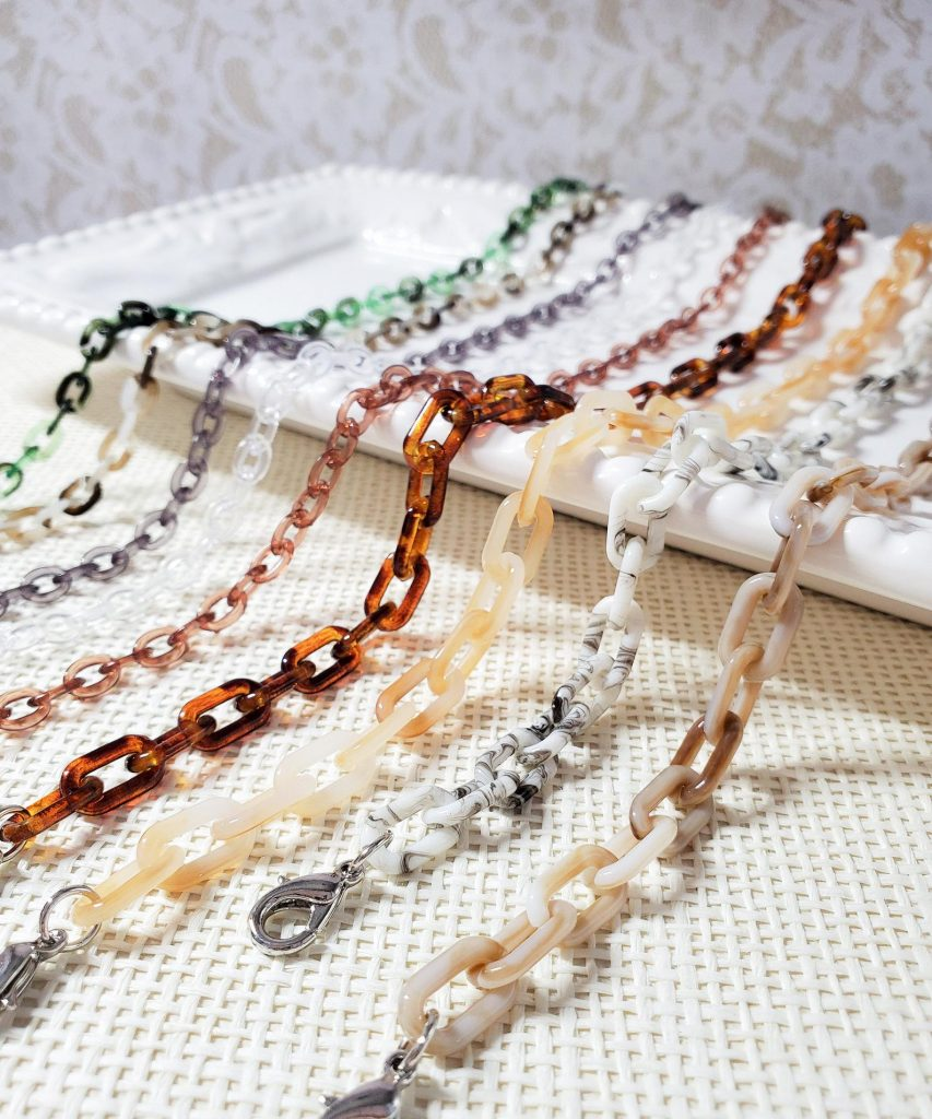 A variety of mask chains in different color tortoiseshell styles.