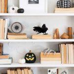 A shelf sprinkled with Halloween decor.