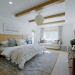 Master bedroom in a coastal design style.