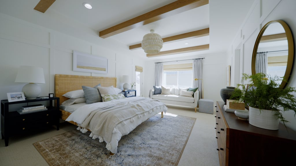A coastal bedroom with white paneled walls, gorgeous oak beams, and coconut shell chandelier.