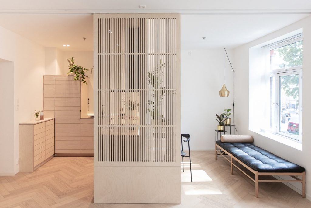 A Japandi style room with light colored wood and well-curated furniture.