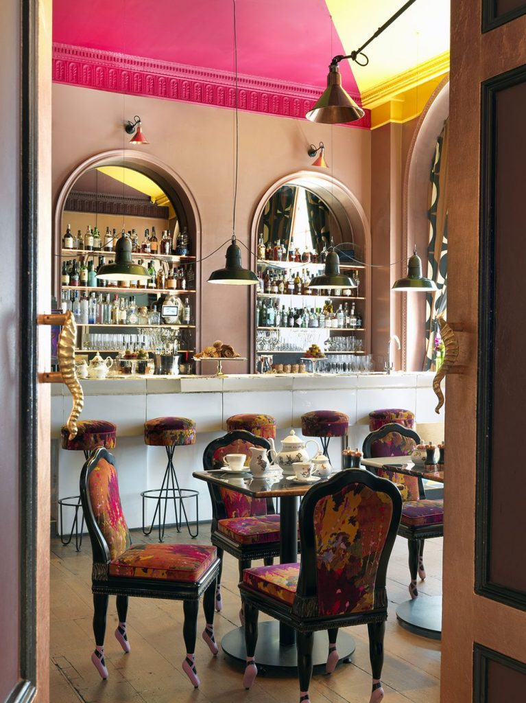 A tea room with eclectic dining room chairs with ballerina feet for the chair legs.