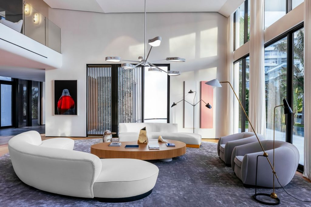 Another living area of the home with curvilinear furniture and unique light fixtures.