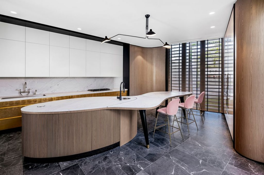 Chef's kitchen with custom sculptural cabinetry with 24-karat gold leaf.