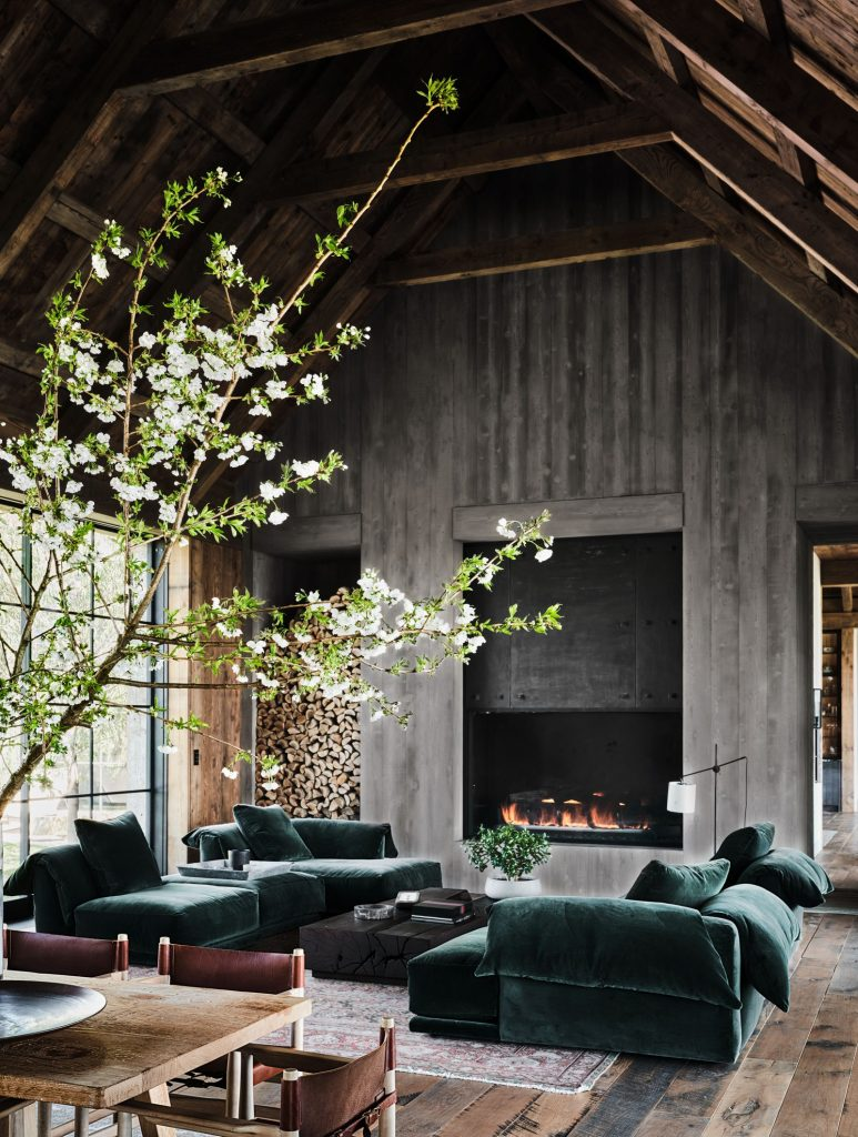 Living room with plush, comfy seating and built-in fireplace.