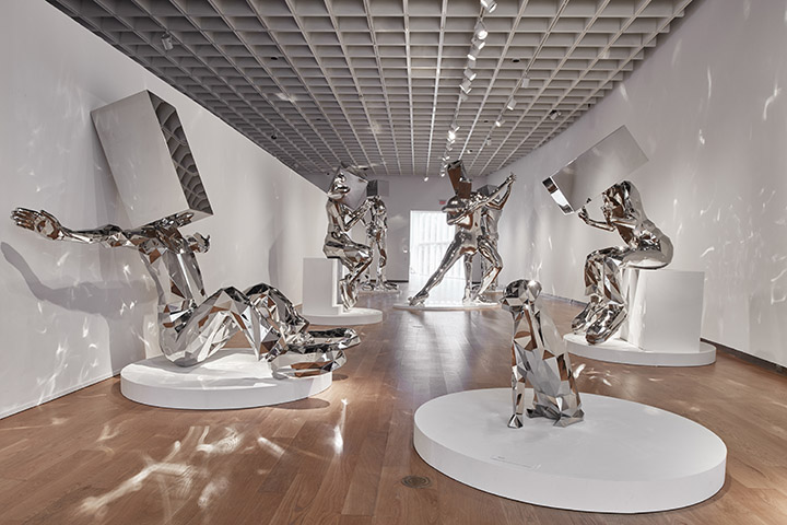 A collection of large stainless steel sculptures from JEFRË's Baks series; large human figures with blocks for heads.