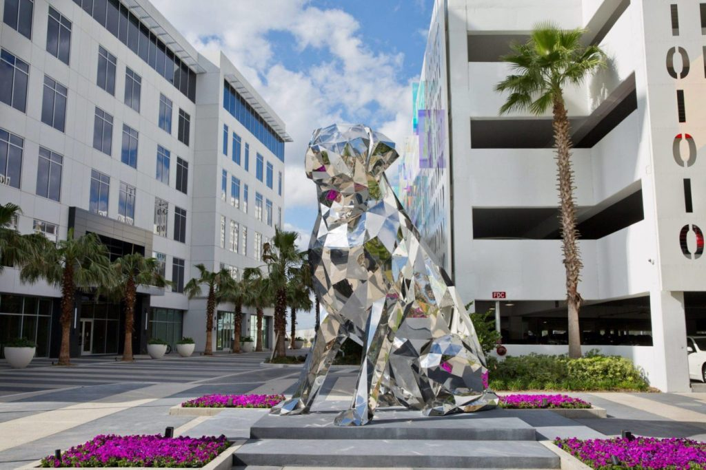 """""""Disco"""", Lake Nona's massive dog sculpture made of stainless steel."""