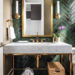 Bathroom with dark green herringbone tiles.