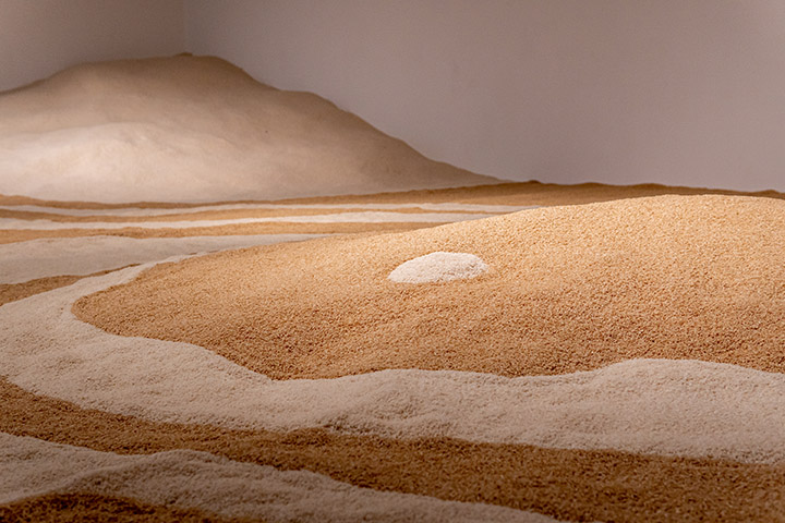 """A close up of JEFRË's installation """"Rice Field"""" made from 10 thousand pounds of white and brown rice."""