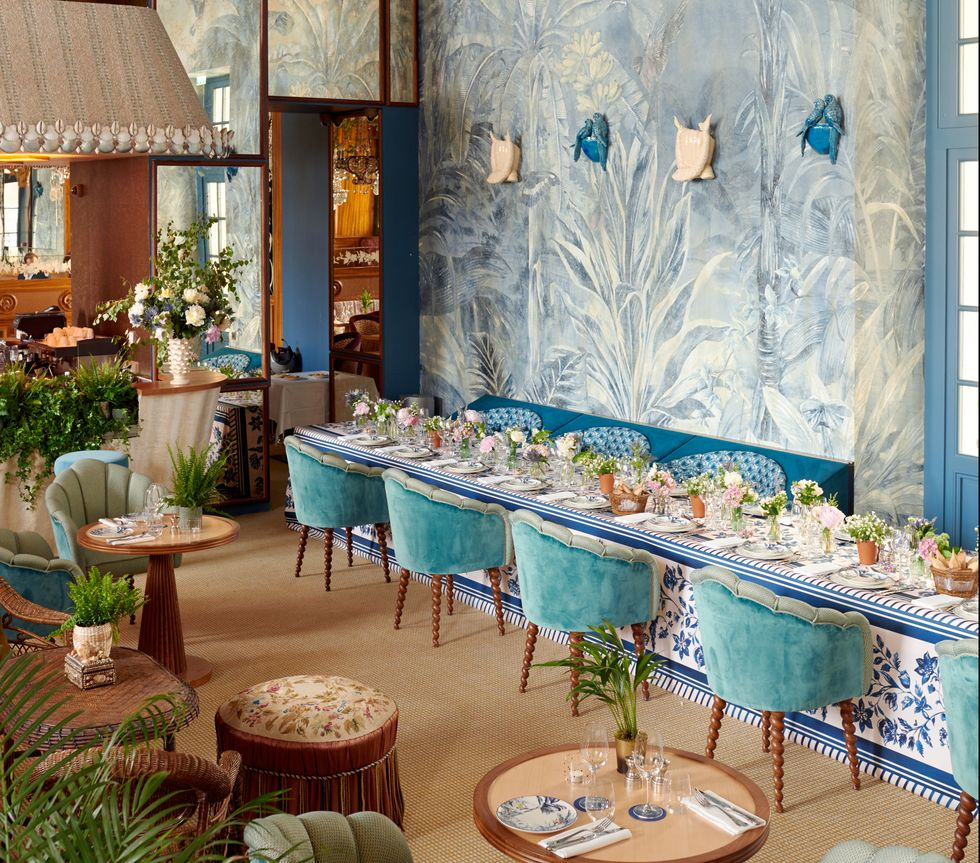 Dining area of Cafe Laperouse with blue color pallete.