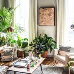A living room filled with plants.