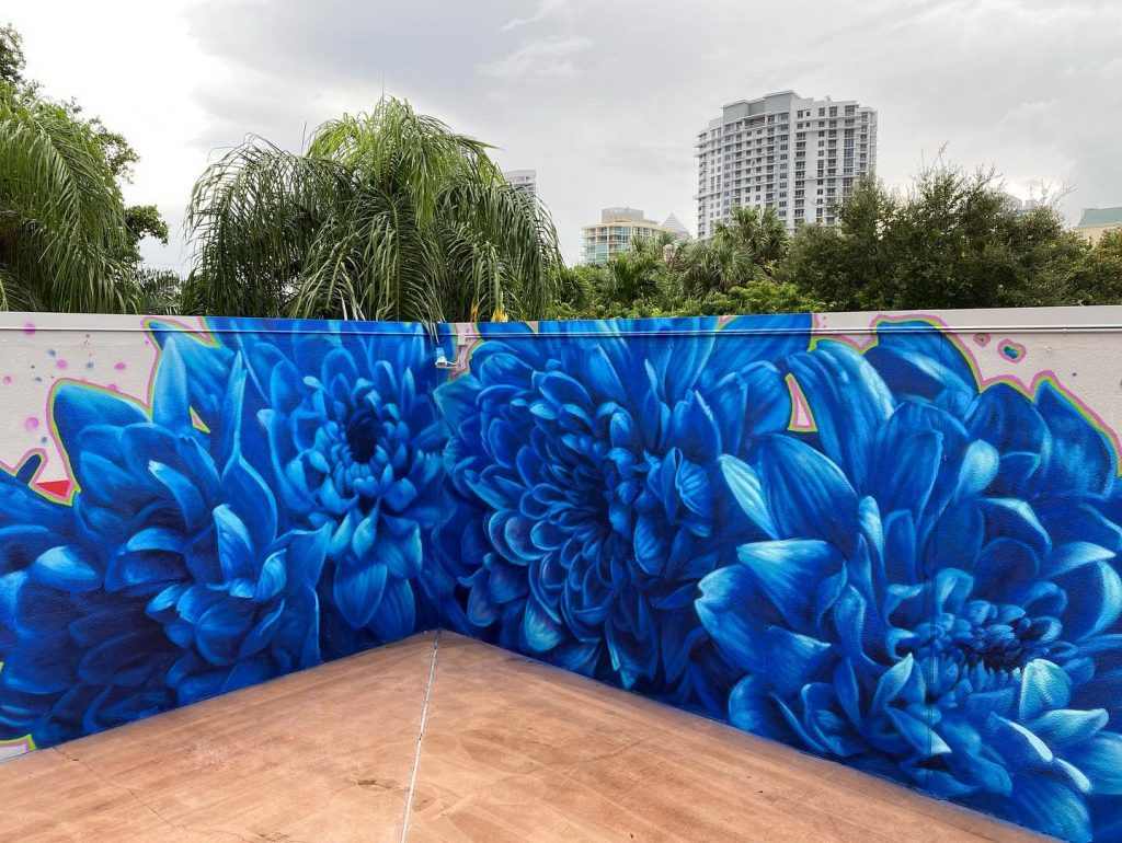 A mural of large bright blue flowers.