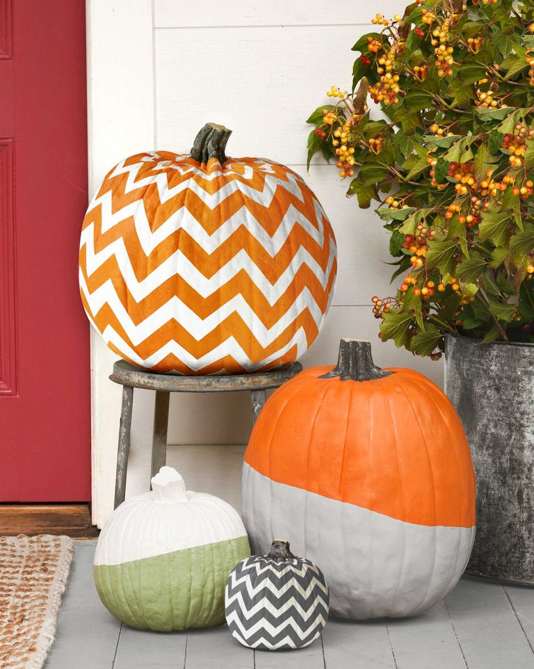 A set of pumpkins painted with patterns.